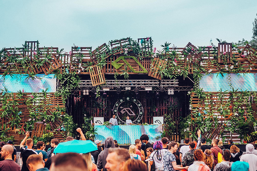 Main stage at Anjunadeep electronic music festival, designed with wooden pallets and foliage